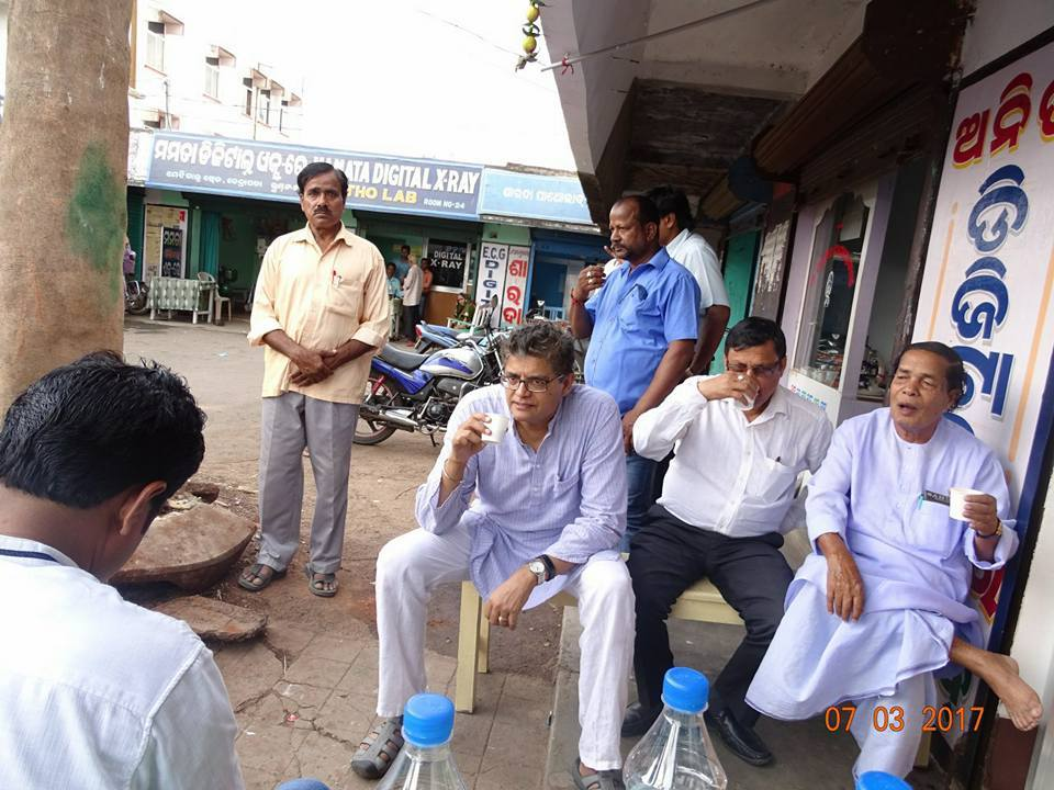 MP Baijayant Jay Panda chatting with local political leaders at a tea shop in Kendrapada
