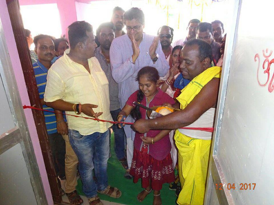 MP Baijayant Jay Panda inaugurates a multipurpose building with a local schoolgirl