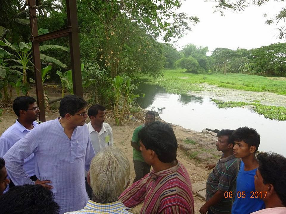 MP Baijayant Jay Panda interacting with constituents about a river clogged with weeds