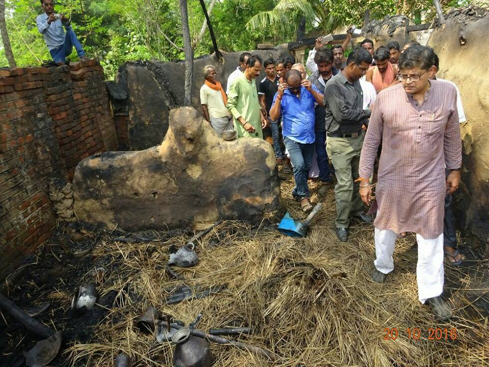 MP Baijayant Jay Panda reviewing residential property of constituent which was destroyed by fire