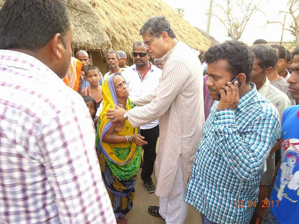 MP Baijayant Jay Panda talking to an old lady regarding her old age pension