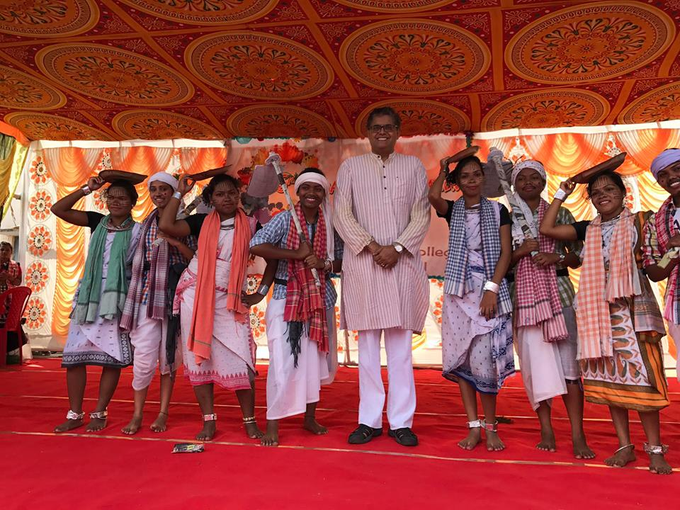 MP Baijayant Jay Panda with Adivasi students performing Kui,a tribal folk dance